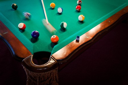 balls and the cue on the pool table photo