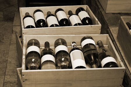 vintages: Red and white wine in bottles in wine shop Stock Photo