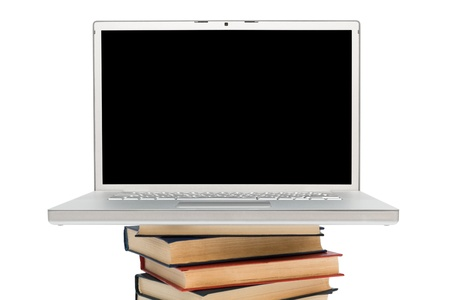 books and new laptop on a white background photo