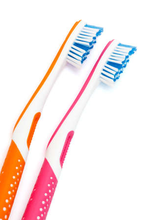two new toothbrushes on a white background photo