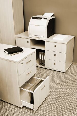 office cabinet: printer from the cabinet in a modern office Stock Photo