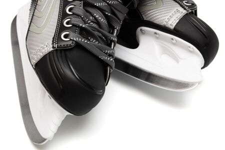 new and modern black skates on white background photo
