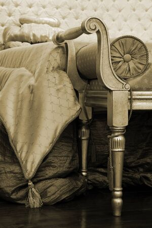 Ancient and beautiful couch in a rich bedroom Stock Photo - 9161530