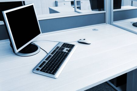 computer on a desk in a modern office photo