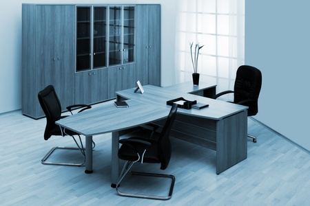 desk and leather chairs in a modern office photo