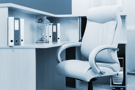 white leather armchair in a modern office photo