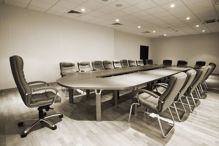auditorium: large table and chairs in a modern conference room Stock Photo
