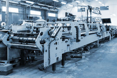 repair of old printing equipment in the printing photo