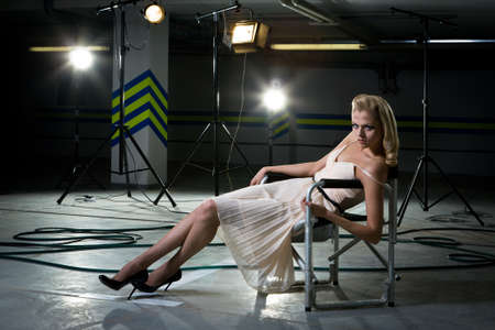 girl in a chair under the rays of searchlights Stock Photo - 9370319