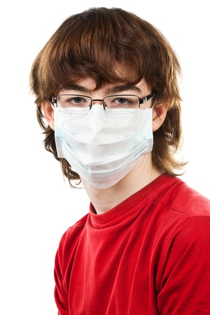 teenager with glasses and mask on a white background photo