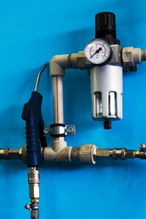 air pressure: The compressor for tyres on a dark blue wall