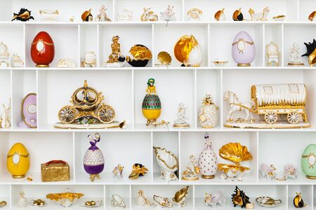 cupboard: ceramic figurines on the white storefront