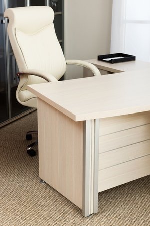 office chairs: white leather armchair in a modern office