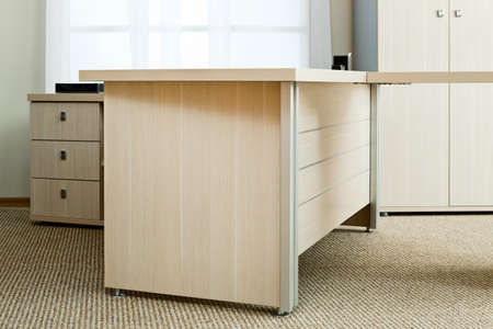 new desk with drawers in a modern office photo