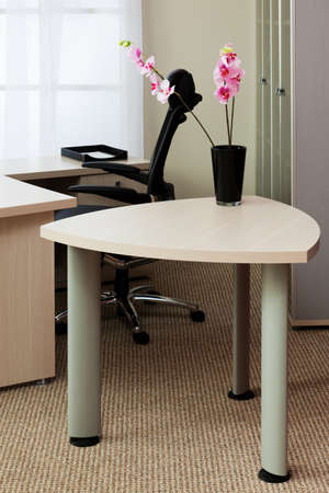orchids on the table in a modern office photo