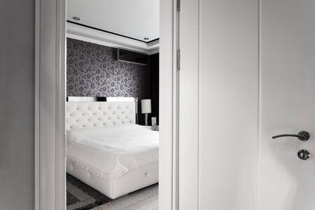 beautiful white bedrooms open door photo