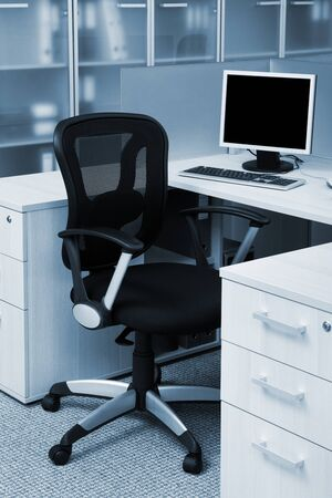neat: computer on a desk in a modern office