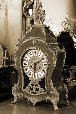 antique keyhole: beautiful antique clock on the background of the mirror