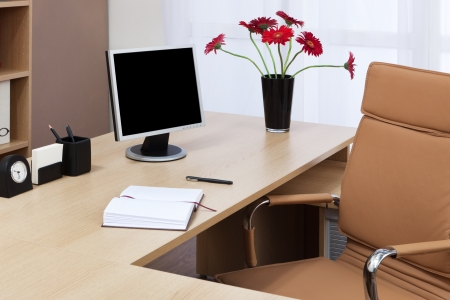 The monitor on a desk at modern office Stock Photo - 10621155