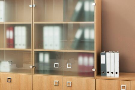 front office: bookcase with glass doors in a modern office Stock Photo