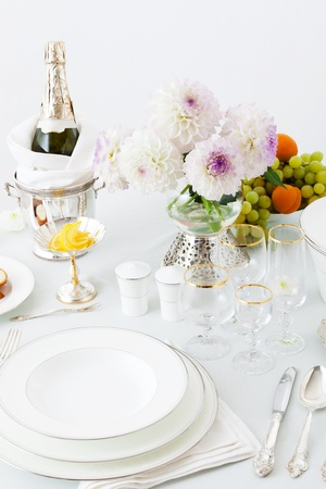 table with dishes and flowers on a white background Stock Photo - 10966287