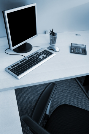 neat: modern computer on a wooden desk in the office Stock Photo