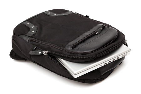 backpack with a laptop on a white background photo