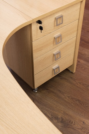 wooden desk with drawers in a modern office photo