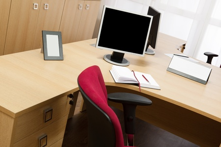 monitors on the desks in a modern office photo