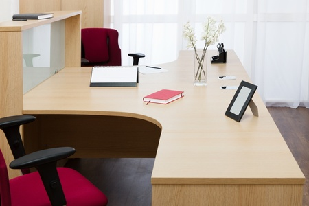 beautiful wooden desk in modern office photo