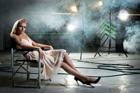 girl on a chair under the rays of searchlights photo