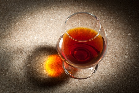 cognac: a glass of cognac on the marble table Stock Photo