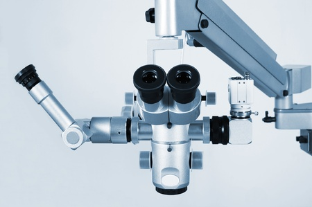 The new and modern medical microscope with the digital camera photo