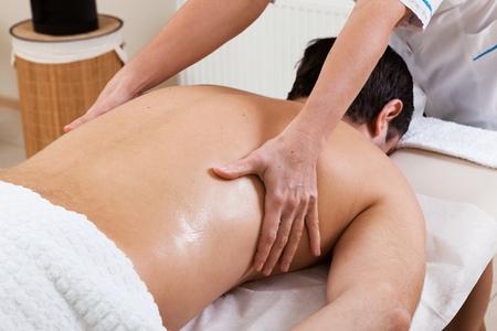 Massage makes a man a woman in a beauty salon photo