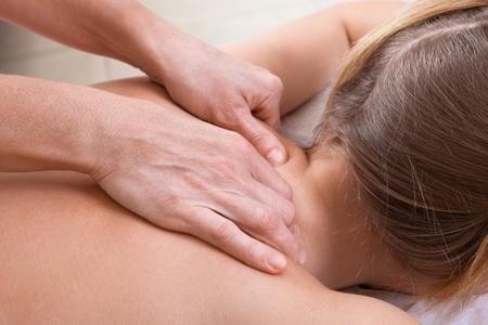 neck massage in a beauty salon Stock Photo