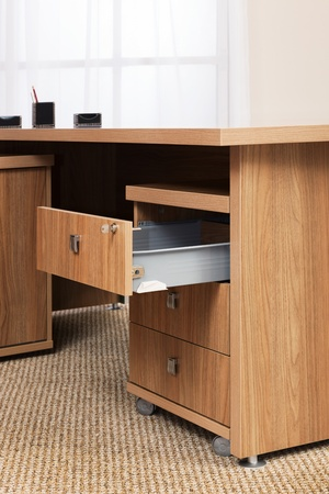 wooden desk with an open box in the office Archivio Fotografico