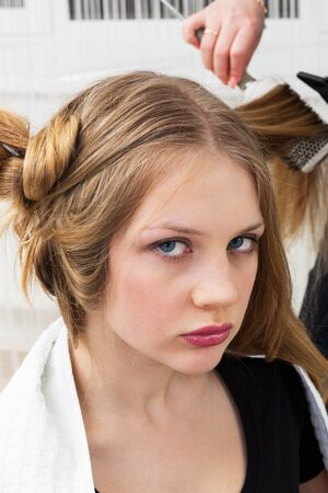 Hair styling in a modern barber shop photo