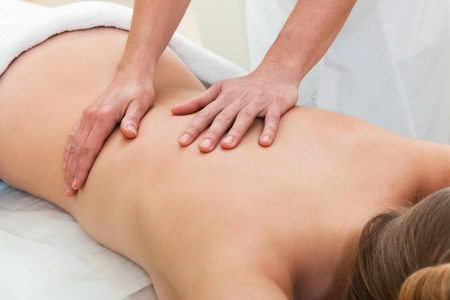 back massage: massage in a modern beauty salon Stock Photo