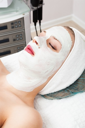 laying of mudpack in modern beauty salon photo