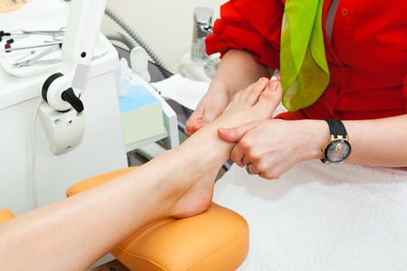 foot massage in a modern beauty salon photo