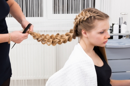 plait: weave braid girl in a hair salon Stock Photo