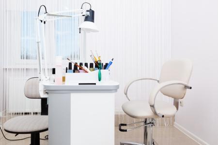 beautiful manicure room in a modern beauty salon photo