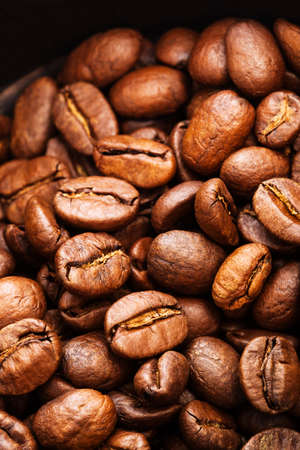 large bean: roasted coffee beans close-up as a background