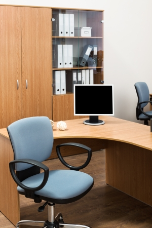 monitor on a desk in a modern office photo