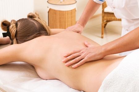 massage girl in a modern beauty salon photo