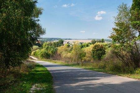 asphalt road to the village on a summer day Stock Photo - 13757001
