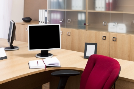 monitors on a desks in a modern office photo