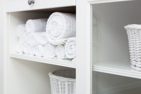 white towel on a shelf in the closet photo