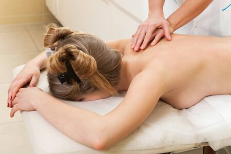 massage girl in a modern beauty salon photo