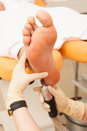pedicure foot male in a modern beauty salon photo